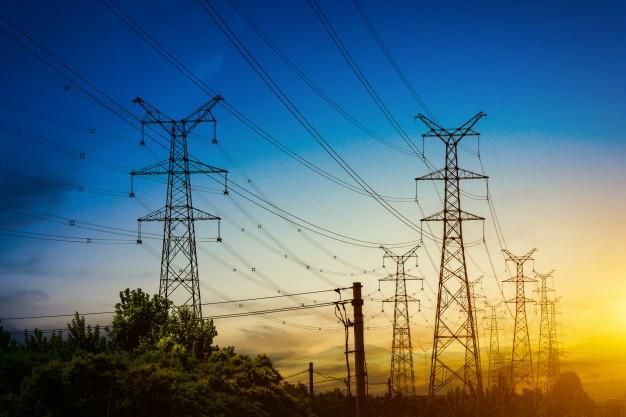 sun-setting-silhouette-electricity-pylons_1127-3239
